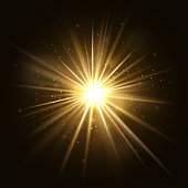 Gold star burst. Golden light explosion isolated on dark background vector illustration