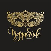 gold venetian carnival mask with hand lettering