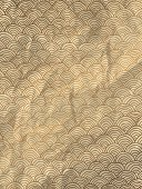 Gold wrapping paper with geometric hand drawn waves