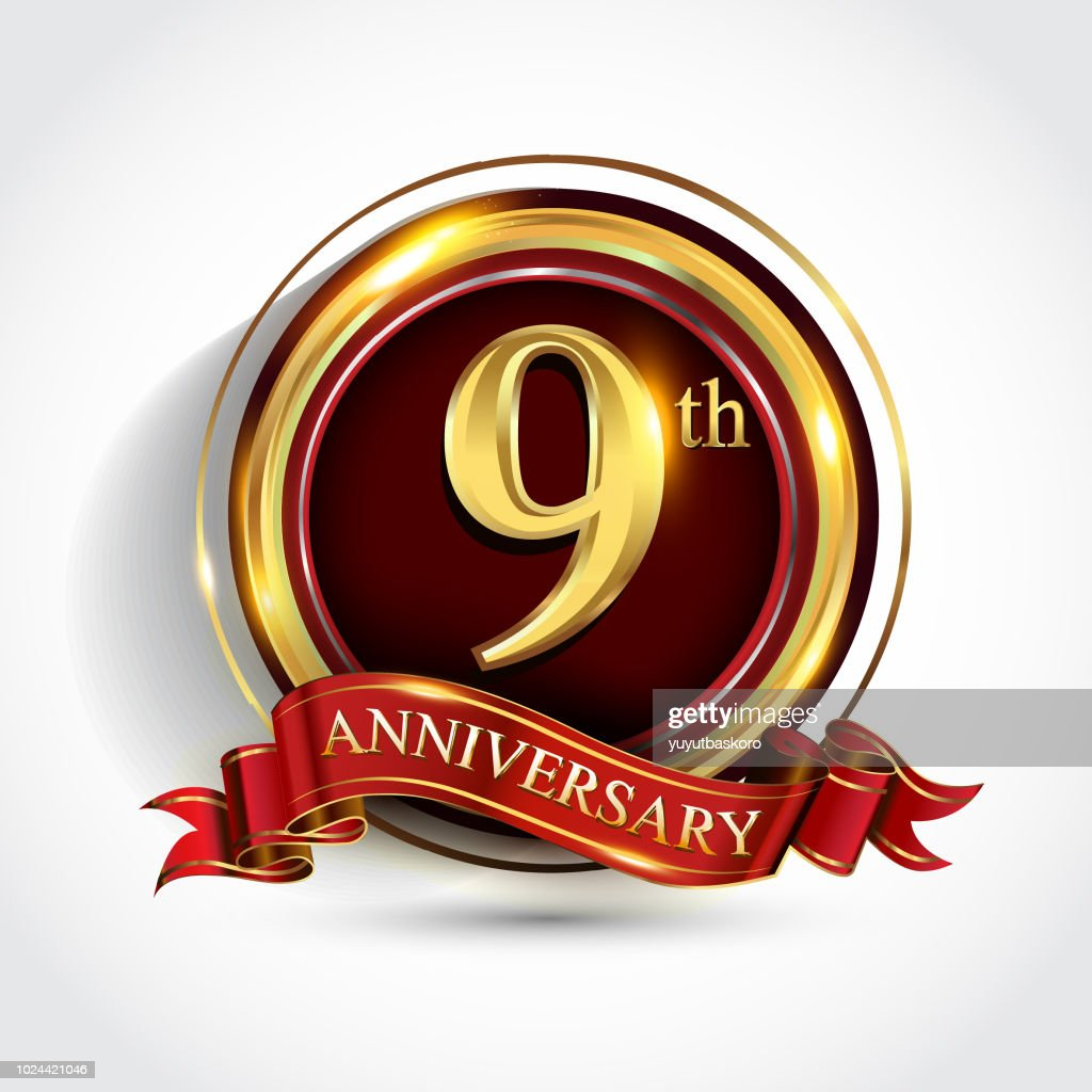 Golden anniversary sign with ring and red ribbon isolated on white background