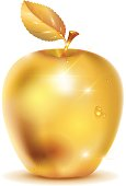 Golden apple with drop of dew