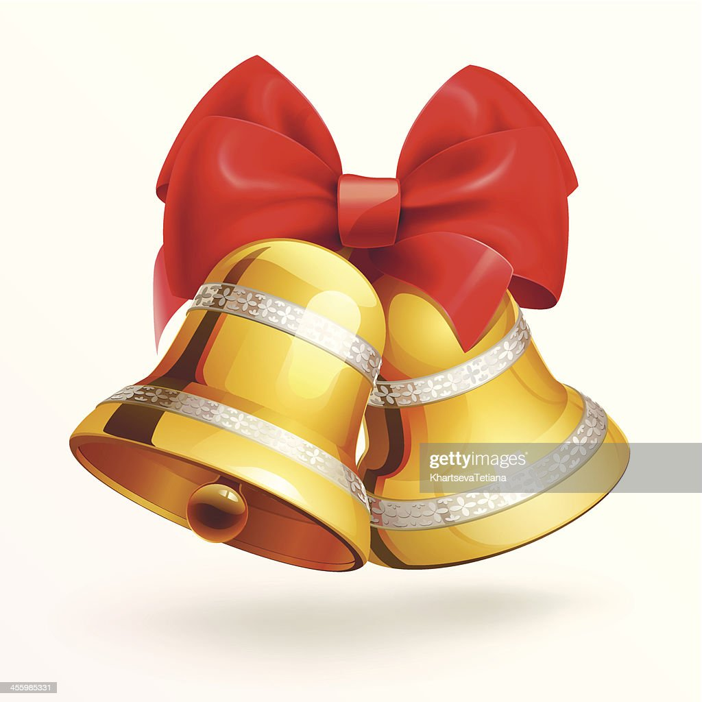 Golden bells with red ribbon on white background .