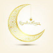 Golden crescent moon on brown background