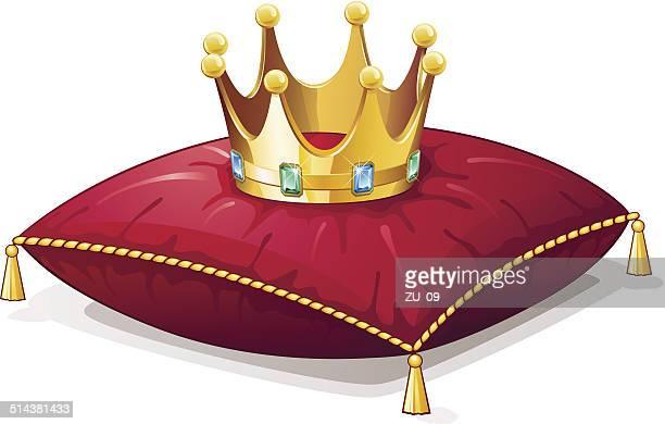 Goldene Krone mit Schmuck auf einem roten Kissen