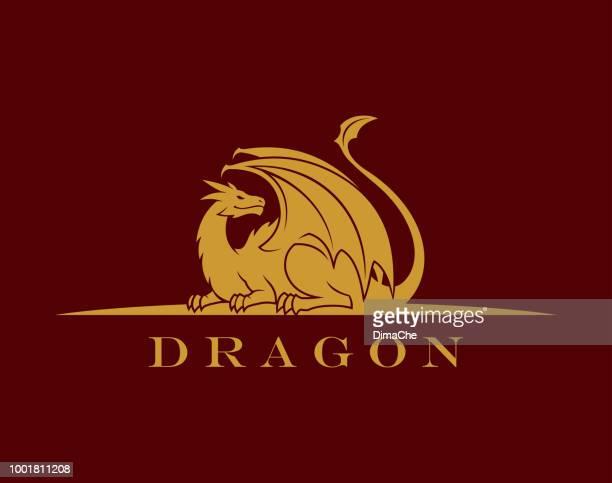 golden dragon silhouette - dragon stock illustrations