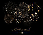 "Golden firework show on black background. ""Make a wish"" concept. Vector illustration"