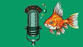 Golden fish and vintage microphone on the air