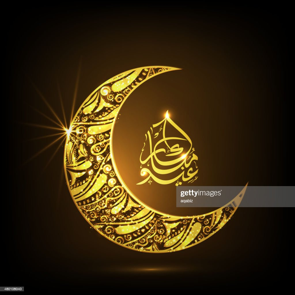 Golden floral moon with Arabic text for Eid.