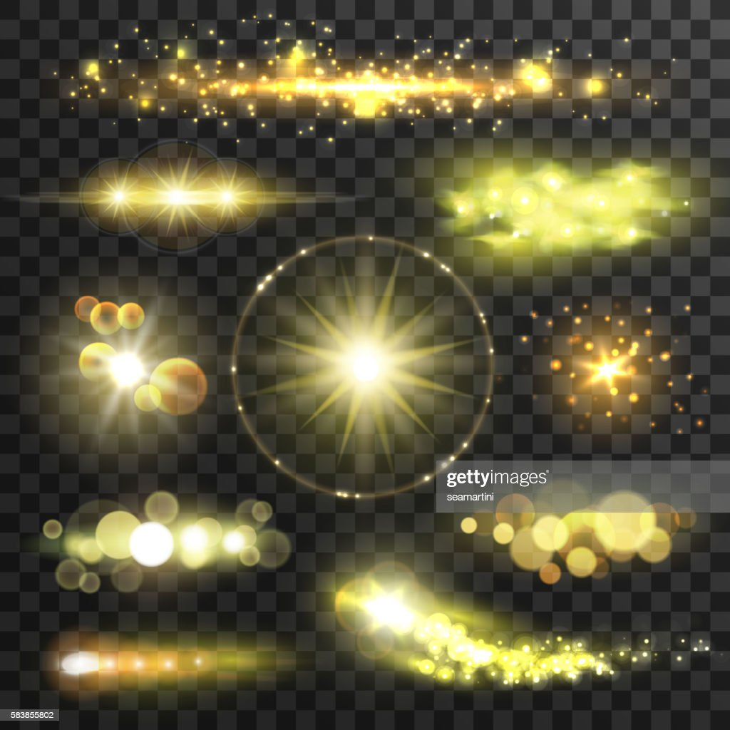 Golden glittering stars with lens flare effect