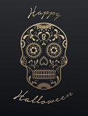 Golden Halloween Skull illustration with traditional ornaments.