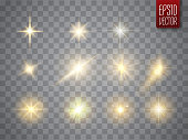 Golden lights sparkles collection. Vector illustration of glowing lens flares, flashes and sparks
