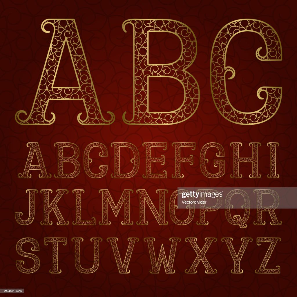 Golden ornamental letters with flourishes on red patterned background
