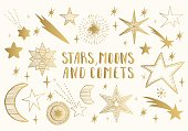 Golden stars, moons, comets. Hand drawn vector.