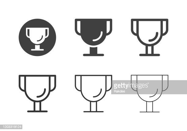 golden trophy icons - multi series - competition group stock illustrations