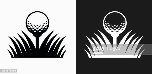 golf ball icon on black and white vector backgrounds - golf ball stock illustrations