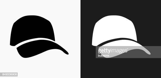 golf cap icon on black and white vector backgrounds - cap stock illustrations
