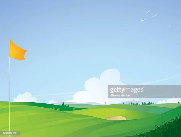 ゴルフコースの景観にオレンジの前で国旗