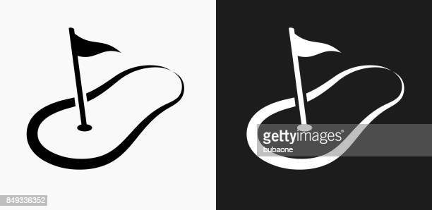 golf hole flag icon on black and white vector backgrounds - golf flag stock illustrations