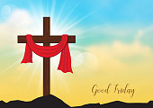 Good Friday. Background with wooden cross and sun rays