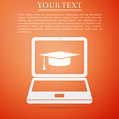 Graduation cap and laptop icon. Online learning or e-learning concept icon isolated on orange background. Flat design. Vector Illustration