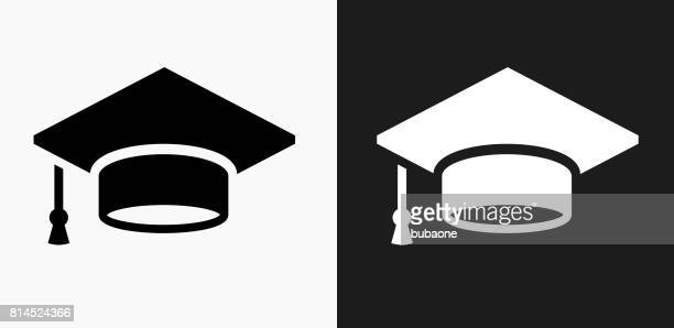graduation cap icon on black and white vector backgrounds - hat stock illustrations