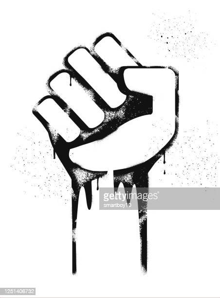 graffiti graphic of clenched fists - stencil stock illustrations