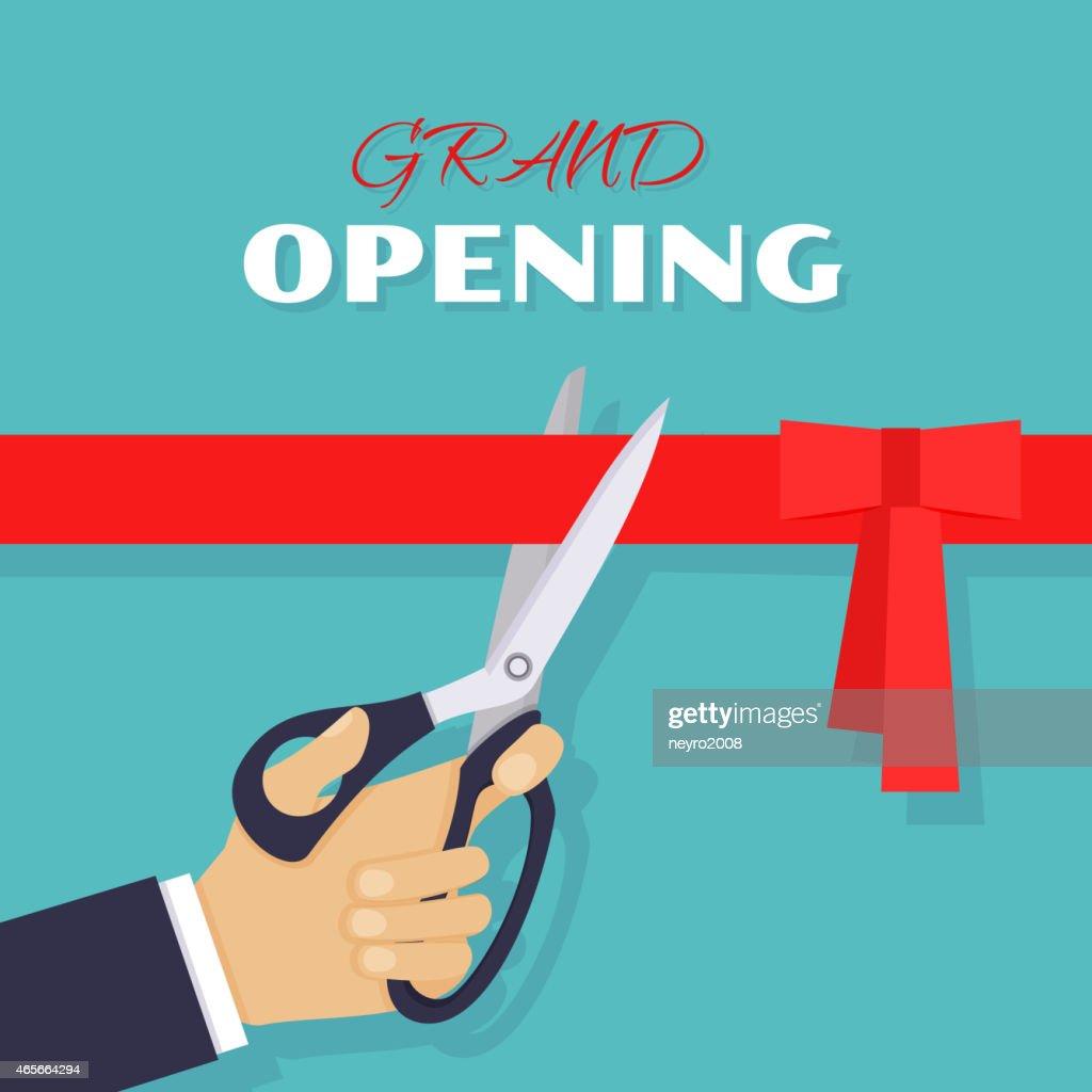 Grand opening. Scissors cut red ribbon