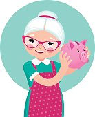 Grandmother a pensioner in an apron shakes a piggy bank