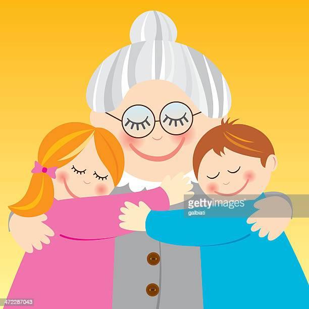 Abuela abrazándose sus nietos