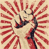 Graphic of a faded red and black fist