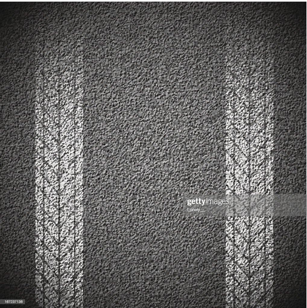 Gray asphalt texture with white tire tread marks