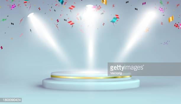 gray studio background with realistic podium spotlight and confetti - ceremony stock illustrations