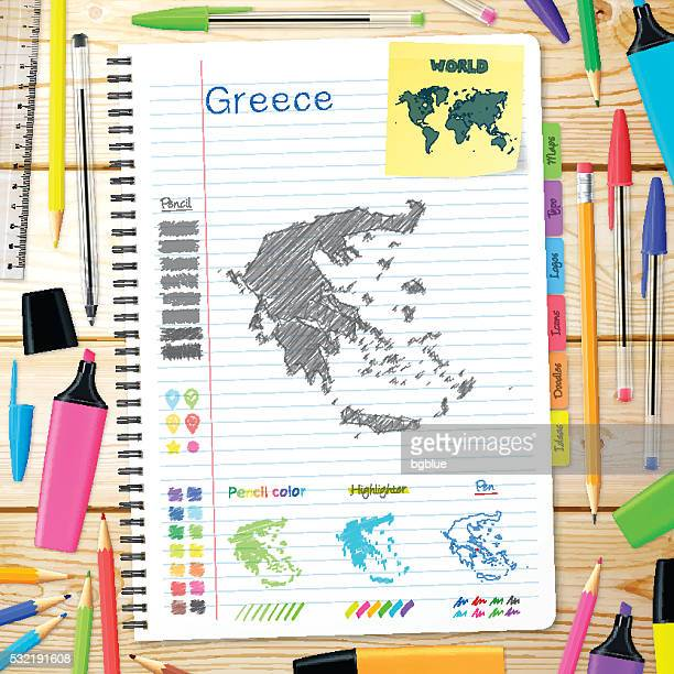 greece maps hand drawn on notebook. wooden background - athens georgia stock illustrations, clip art, cartoons, & icons