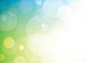 Green and blue bokeh background with luminosity and transparent circles