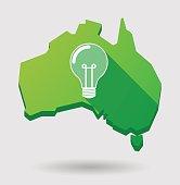 Green Australia map shape icon with a light bulb