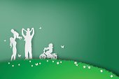 Green background happy family having fun playing in the field,vector,paper art style