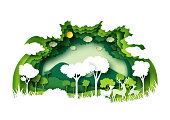Green forest and wildlife with nature background layers paper art style