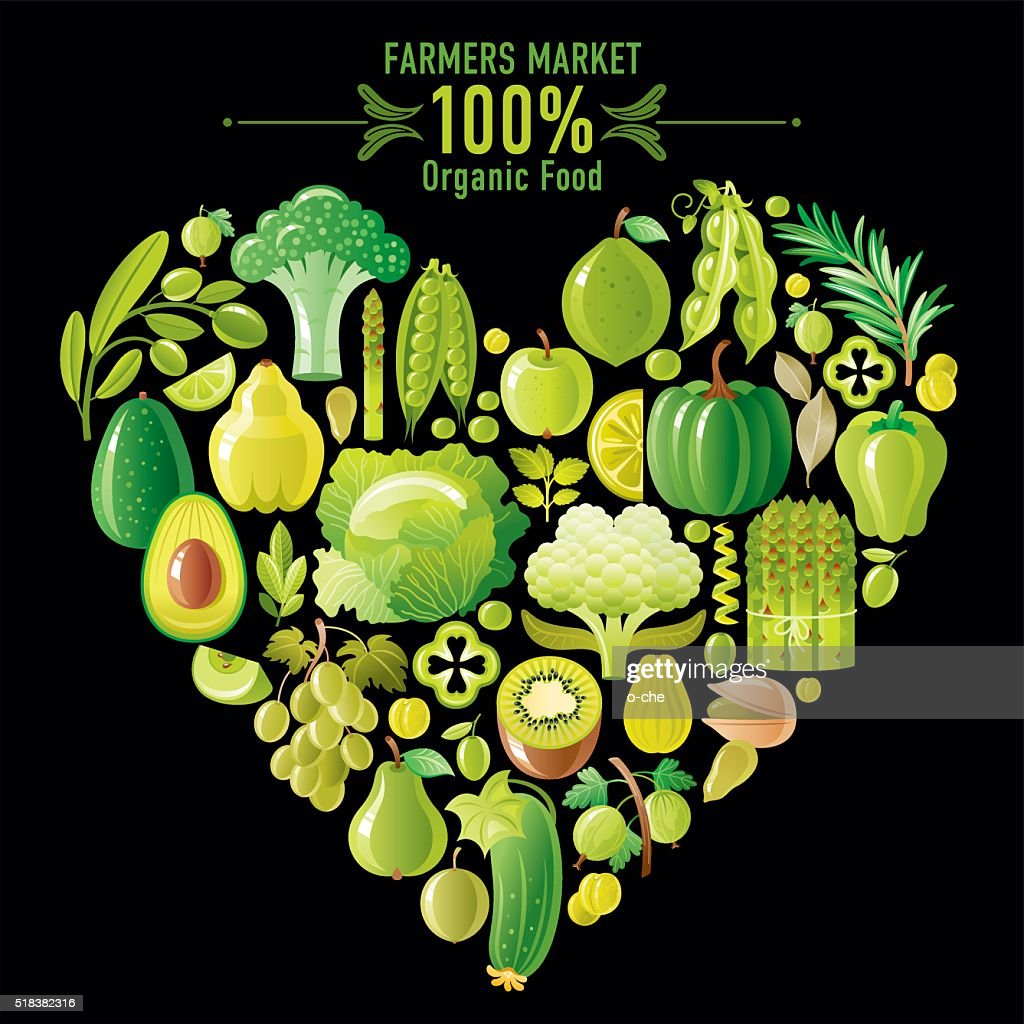 Green fruits and vegetables heart shape on black background