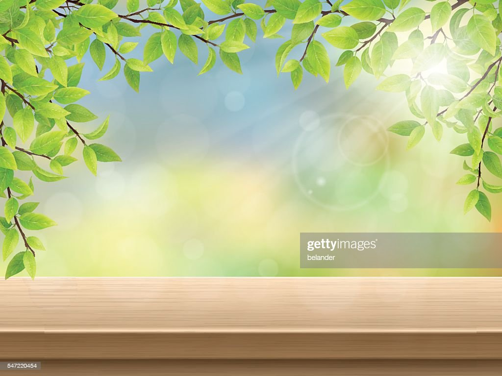 green leaves wooden deck table