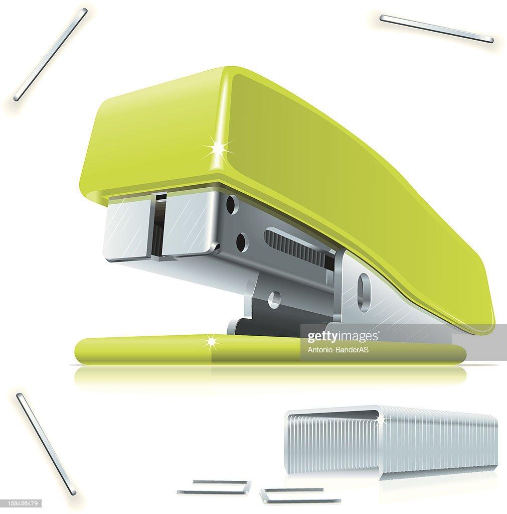 Green stapler circled by staples