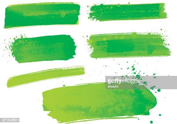Green watercolor paint strokes