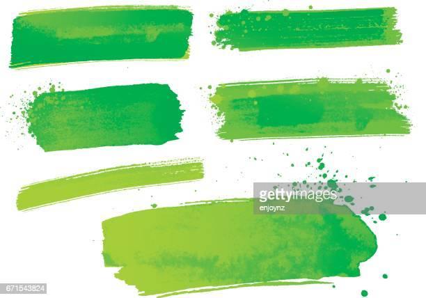 Groene aquarel penseelstreken