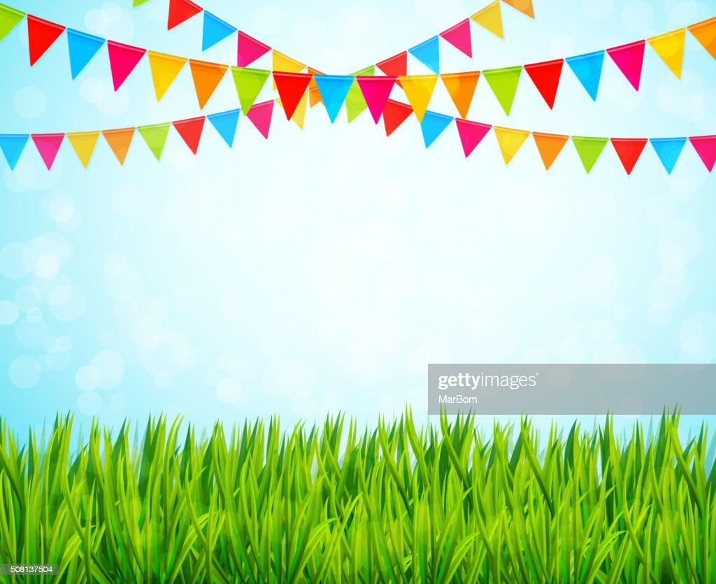 Greeting card with colorful flags and green grass
