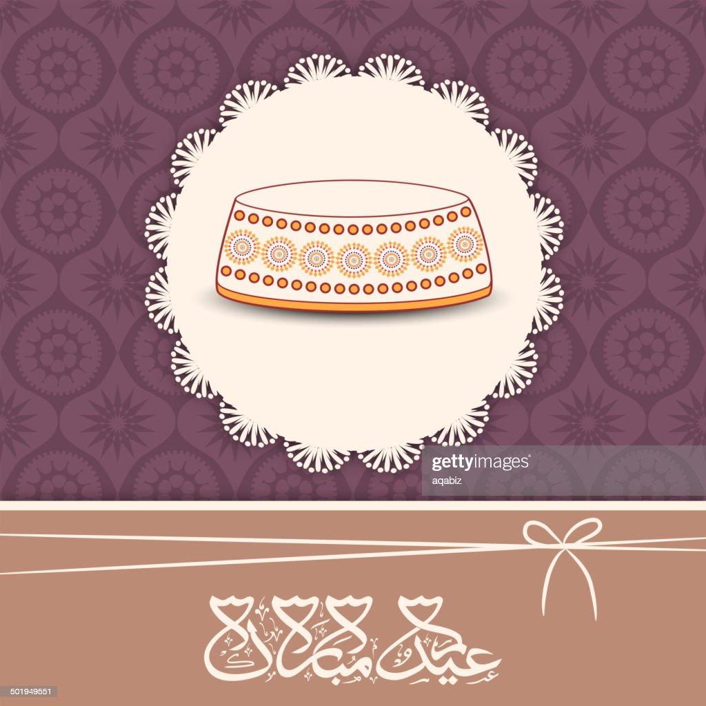 Greeting with islamic cap and arabic text Eid Mubarak.