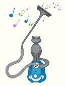 Grey cat sits on a vacuum cleaner