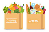 Grocery in a paper bag and vegetables and fruits in paper bag.
