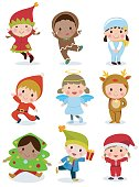 Group of cute kids wearing Christmas costumes