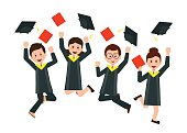 Group of happy graduates throwing graduation hats in the air