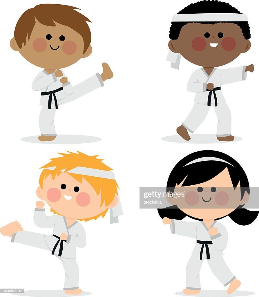 Group of karate kids wearing martial arts uniforms