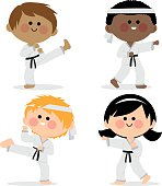 Group of karate kids wearing martial arts uniforms